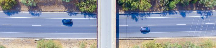 Two paralel cars crossing the bridge. View from above of two paralel cars crossing the bridge in opposit ways Stock Images