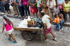 Popayán, Colombia - 5 January 2014 : Black and White Carnival f. View from above of two people with a cart selling foam and flour at the Carnival de Negros y royalty free stock photography