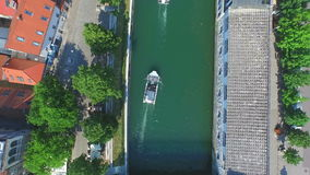 View from above of two white boats floating on river in Ljubljana. stock video