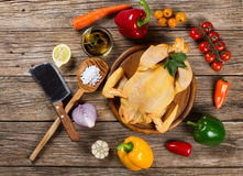 View from above of uncooked chicken with vegetables Royalty Free Stock Photos