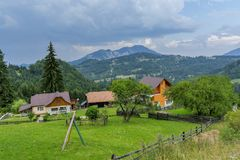 Countryside view in Transylvania. View from above of a village in the Romanian countryside. Mountains and cloudscape in the background Royalty Free Stock Photography