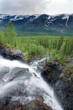 View from above waterfall on forest and mountains Royalty Free Stock Photography