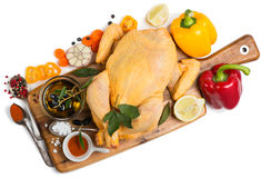 View from above of whole raw chicken ready to roast with cooking Royalty Free Stock Images