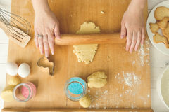 View from above of woman rolling dough with wooden pin Royalty Free Stock Photo