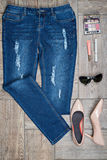 View from above of woman's jeans and accessories Royalty Free Stock Photos