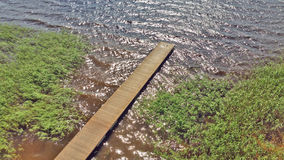 View from above on a wooden pier, on the lake shore Stock Photo