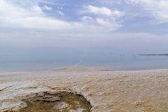 View from above of Sunset Coastal View of Dead Sea - salt lake wi. Sunset Coastal View of Dead Sea - salt lake with High salinity level and  Earth`s lowest Royalty Free Stock Photo