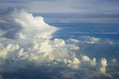 View of abstract dense soft fluffy white cloud copyspace with shades of blue sky and earth background from above flying airplane Royalty Free Stock Photos