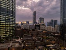 View of Abu Dhabi city towers and buildings with some storm clouds.  royalty free stock image