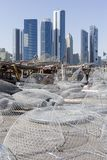 View on Abu Dhabi from the fishing harbour. With nets on the foreground Stock Image