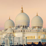 View of Abu Dhabi Sheikh Zayed Mosque at sunset Stock Photography