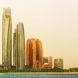 View of Abu Dhabi Skyline and Al Bateen marina at sunset, UAE Stock Photo