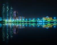 View of Abu Dhabi Skyline at night, UAE. View of Abu Dhabi Skyline at night with reflection on water, United Arab Emirates Stock Image