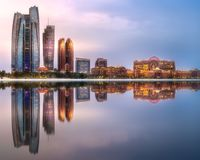 View of Abu Dhabi Skyline at sunrise, UAE. View of Abu Dhabi Skyline at sunrise with cloudy sky, United Arab Emirates stock photo