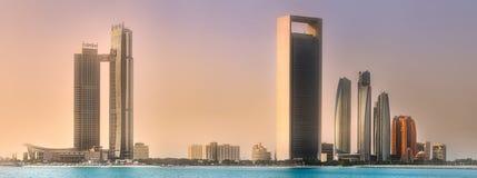 View of Abu Dhabi Skyline at sunrise, UAE. View of Abu Dhabi Skyline at sunset, United Arab Emirates Stock Photo