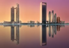 View of Abu Dhabi Skyline at sunrise, UAE. View of Abu Dhabi Skyline at sunrise, United Arab Emirates. Clipping path of sky royalty free stock photo