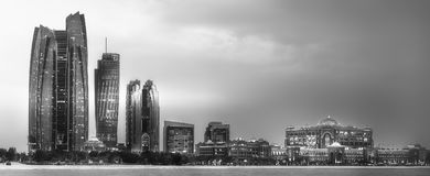 View of Abu Dhabi Skyline at sunrise, UAE. View of Abu Dhabi Skyline at sunrise with cloudy sky, United Arab Emirates . Black and white concept Royalty Free Stock Images