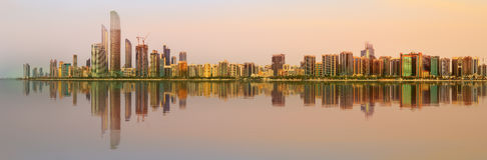 View of Abu Dhabi Skyline at sunset, UAE stock images