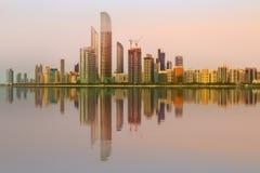 View of Abu Dhabi Skyline at sunset, UAE stock photography
