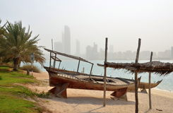 View on Abu Dhabi skyline with traditional boat in forefront, UAE Royalty Free Stock Photography