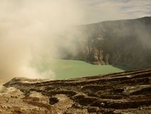 View on the acidic crater lake of the Ijen volcano in Indonesia, a sulfur mine and toxic gaz. View on the acidic crater lake of the Ijen volcano in Java royalty free stock image