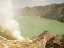 View on the acidic crater lake of the Ijen volcano in Indonesia, a sulfur mine and toxic gaz. View on the acidic crater lake of the Ijen volcano in Java stock photo
