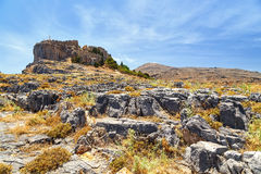 View of the Acropolis  Lindos from rocks below. Rhodes Greece Stock Photography