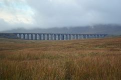 View across Batty Moss to the Ribblehead Viaduct. On a cloudy misty autumnal day in october. low cloud makes the image moody and a feel of isolation. Victorian royalty free stock photo