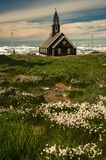 View across the meadow to a Zion church in Ilulissat, Greenland royalty free stock photo
