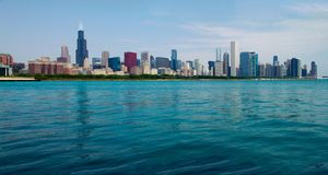 Chicago Loop Skyline As Seen From the Water. View across the brilliant blue waters of Lake Michigan of the famous Chicago Skyline, replete with scores of Royalty Free Stock Photography