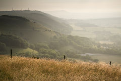 View across English countryside landscape during late Summer eve. English countryside landscape during late Summer afternoon with dramatic sky and lighting Stock Images