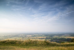 View across English countryside landscape during late Summer eve. English countryside landscape during late Summer afternoon with dramatic sky and lighting Royalty Free Stock Images