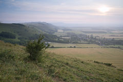 View across English countryside landscape during late Summer eve Stock Images