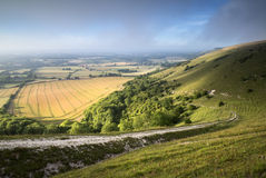 View across English countryside landscape during late Summer eve Stock Photos