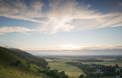 View across English countryside landscape during late Summer eve. English countryside landscape during late Summer afternoon with dramatic sky and lighting Royalty Free Stock Image