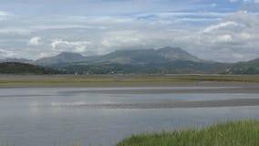 View across an estuary toward Snowdonia stock video