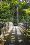 A view across the Inverted Bowstring Bridge across the Roe river in the Roe Valley country park near Limavady in County Londonderr Stock Image