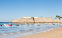 The Castle of Santa Catalina in Cadiz. The view across La Caleta beach towards the castle of Santa Catalina in Cadiz, Spain Royalty Free Stock Photography