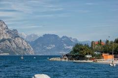 View across Lake Garda from beach near Macesine. View across the lake from beach near Malcesine, Lake Garda in Italy stock photos