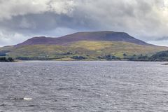 A view across Llyn Celyn. Towards Arenig Fach and a cloudy sky Royalty Free Stock Photography
