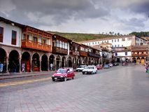 Cusco, Peru - October 25, 2006: View Across Main Square. View across main square of Cusco in Peru showing colonial style balconies and tourists walking in the royalty free stock image