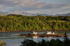 View Across the Menai Straits. From Anglesey North Wales UK with a fish farm island Stock Photos