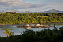 View Across the Menai Straits. From Anglesey North Wales UK with a fish farm island Royalty Free Stock Images
