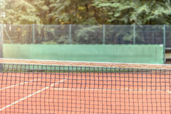 View across the net on a tennis court Stock Photography