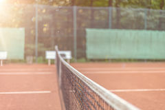 View across the net on a tennis court Royalty Free Stock Photos