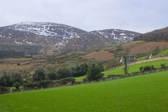 A view across one of the many snow topped hills and valleys of the Mourne Mountains in County down in Northern Ireland on a dull m stock photos
