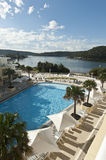 View across the resort pool. Early morning with the river in the background Stock Photography