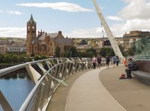 A view across the River Foyle from the iconic Peace Bridge to the famous Londonderry City Guild Hall Royalty Free Stock Photos