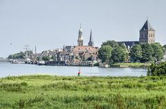 Kampen from across the river. View across the river IJssel and its floodplain towards the old Hanze city of Kampen, The Netherlands stock image