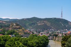 View across the River Mtkvari over the Old Town district towards the Tbilisi TV Tower on Mtatsminda mountain. Travel royalty free stock photos